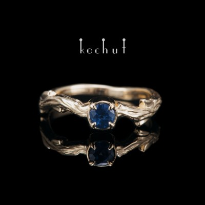Ring «March Twig». Yellow gold, sapphire