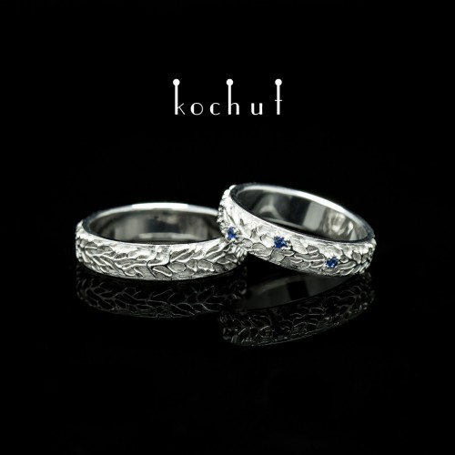 "Wedding rings ""Forest"". White gold, white rhodium, sapphires"