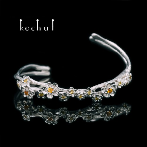 Bracelet «Blooming». Silver, white rhodium, yellow and orange sapphires