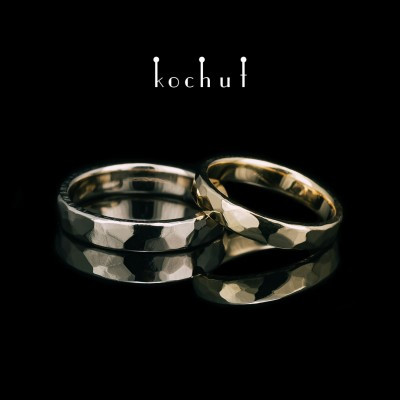 Classic wedding rings with forging Light. White and yellow gold