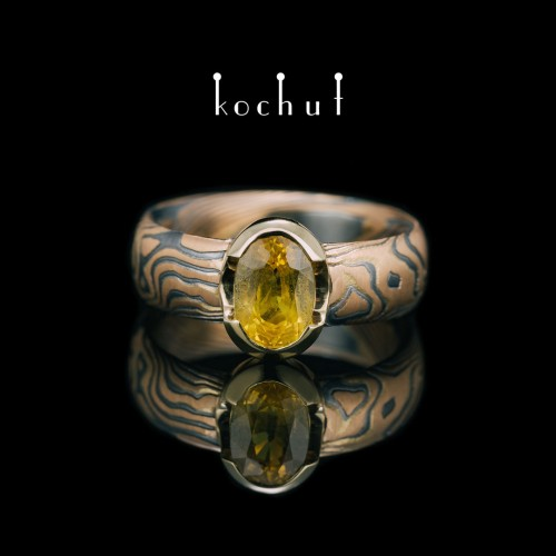 Ring mocume «Sophora. Nectar». Red and yellow gold, etched silver, oxidation, yellow sapphire