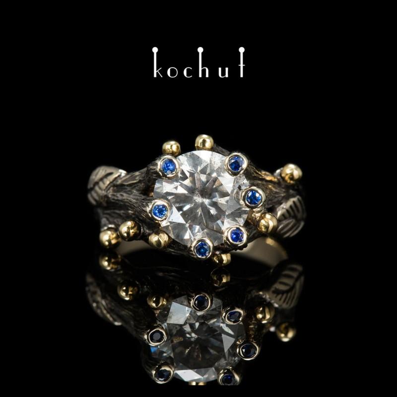 Каблучка на заручини «Торжество життя». Біле золото 750-ї проби, жовте золото, діамант, сапфіри, чорний родій