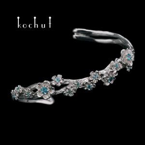 Bracelet «Blooming». Silver, white rhodium, topazes