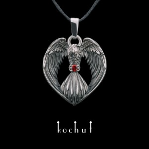 The pendant «Phoenix ». Silver, oxidation, garnet