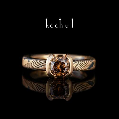 Ring «Mokume». Red gold, silver, brown diamond