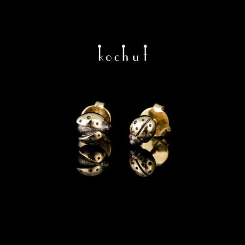 Earrings-studs «Suns». Yellow gold, black rhodium