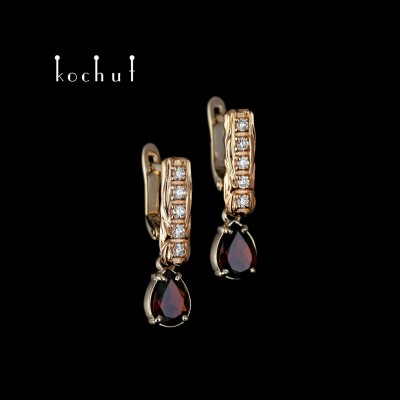 Earrings «Tears of joy.» Red and white gold, garnet, diamonds