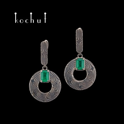 Mokume earrings «Precious Astrolabe». Palladium gold, etched silver, emeralds, oxidation
