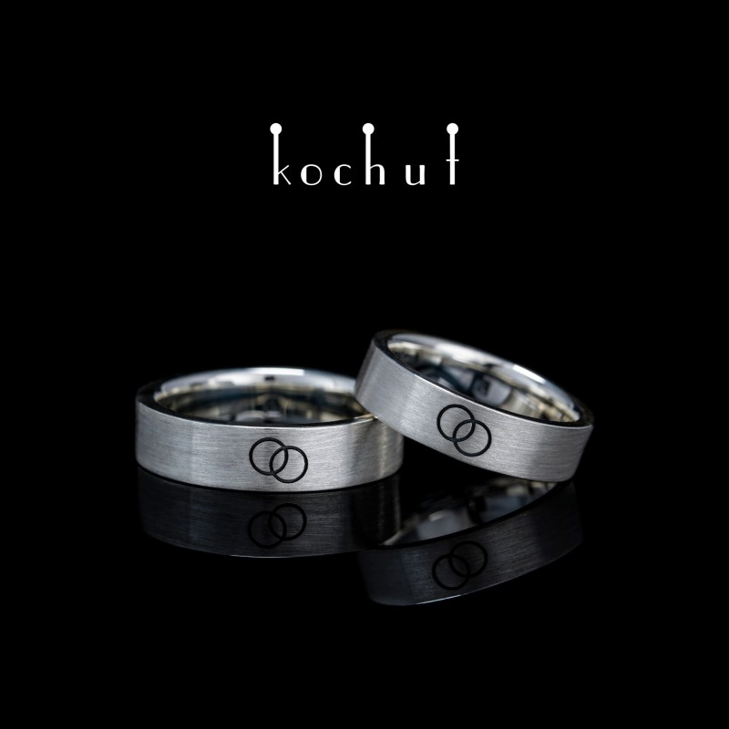Flat-shaped wedding rings «In unison». Silver, oxidation